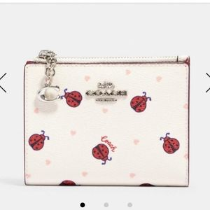 💜NWT Coach Snap Card case with ladybug print